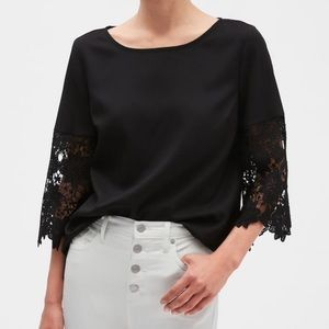 Price is firm ❣️ NWT black shirt with lace sleeves